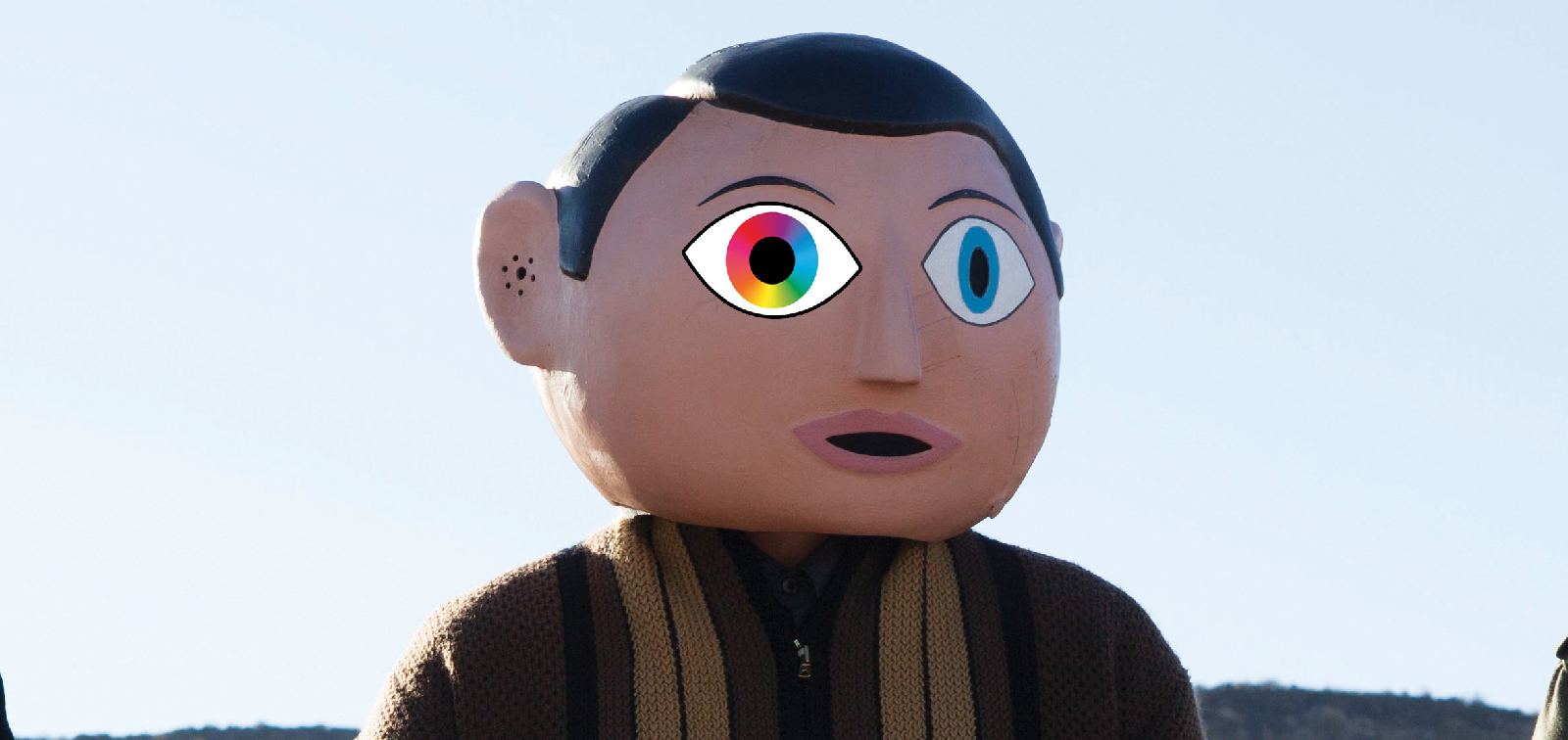 "An edited still from Lenny Abrahamson's ""Frank"", starring Michael Fassbender. We have superimposed the SFF 2014 logo onto his eye because we think we're clever."